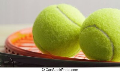 Tennis racket and balls close up. High quality FullHD footage