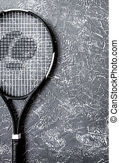 tennis racket on gray background top view