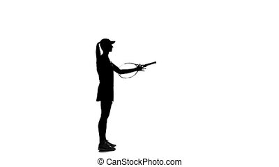 Tennis racket twirling on his finger. Slow motion. White background
