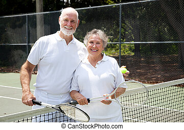 Tennis Senior Couple - Portrait of a happy senior couple on...