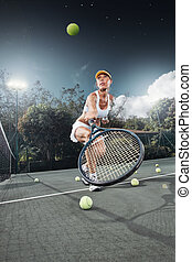 tennis - portrait of young beautiful woman playing tennis in...