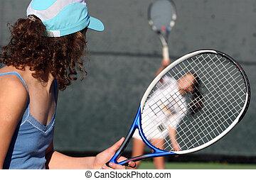 Tennis - Two girls playing tennis