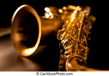 Tenor sax golden saxophone macro with selective focus on black