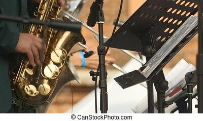 Tenor Saxophone brass band close to