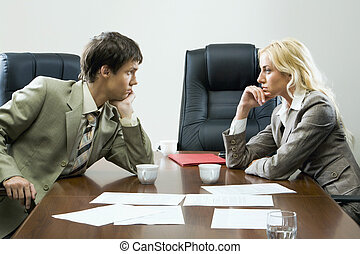 Tense negotiations - Two business people in front of each ...