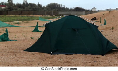 tent at the beach - green camping tent on the beach at...
