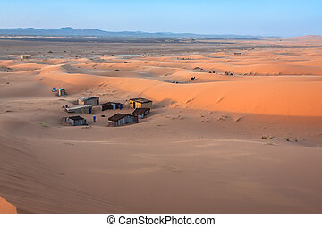 Tent camp for tourists in sand dunes of Erg Chebbi at dawn, Morocco