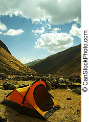 Tent in the Andes mountain - Yellow tent in the mountain