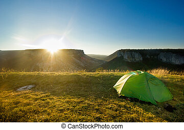 tent in the mountains at sunrise