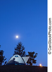 Tent in twilight with moon and fire vertical - Camping in ...