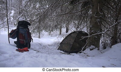 tent is among snowy winter forest - after spending night in...