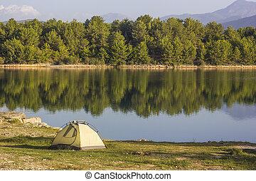 tent near lake at sunrise in turkey