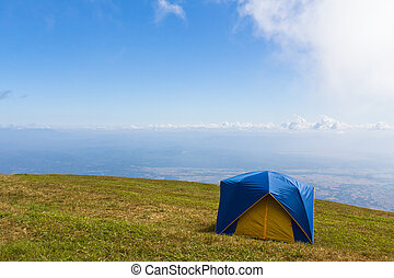 Tent on a grass under  blue sky