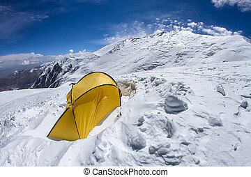 Tent on a slope of Lenin Peak in Kyrgyzstan. Camp 2, 6100 meters.