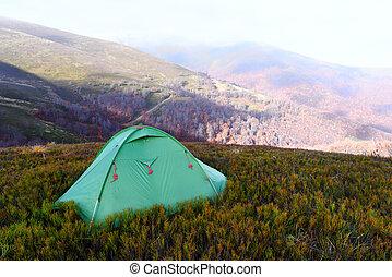 Tent on autumn mountains