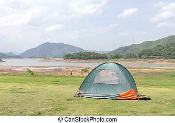 Tent on the lawn With rivers, mountains, and skies in the background