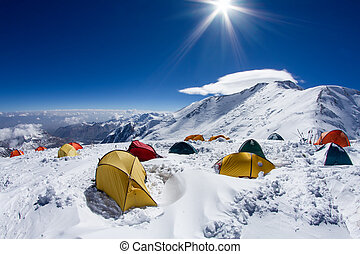 Tents on a slope of Lenin Peak in Kyrgyzstan. Camp 2, 6100 meters.