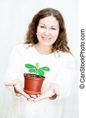 tenue femme, pot fleurs, vert