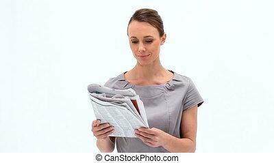 tenue, femme souriant, magazine