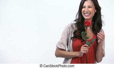 tenue, femme souriant, rose