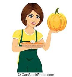 tenue femme, tarte, fraîchement, fait maison, beau, cuit, citrouille, jeune