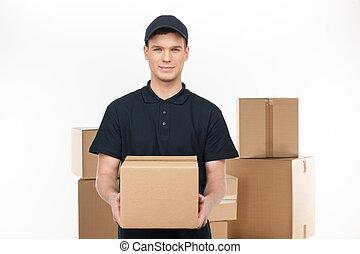 tenue, gai, pile, confiant, jeune, quoique, devant, boîte carton, debout, deliveryman, deliveryman.