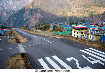 LUKLA, NEPAL - MARCH 4: Tenzing-Hillary Airport the most dangerous airport in the world on March 4, 2014 in Lukla, Nepal.