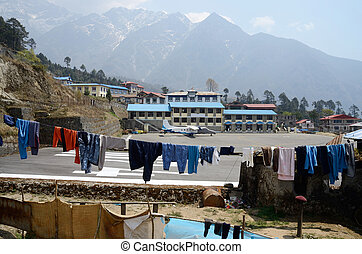 Linen rope with clothes at Tenzing-Hillary Airport in Lukla, Nepal. It's one of the highest airfields in the world