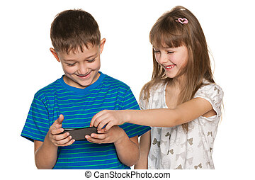Teo children plaing with smartphone