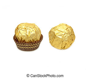 Teo sweet chocolate balls with almond wrapped in gold foil paper on white