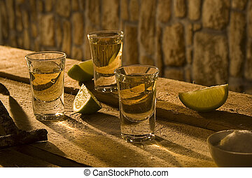 Tequila I - Tequila glasses and lime segments