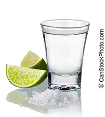 Tequila shot with fresh lime and salt isolated on white ...