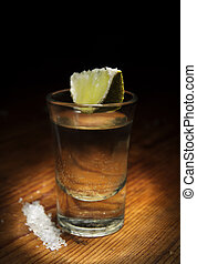 Tequila shot with lime slice and salt