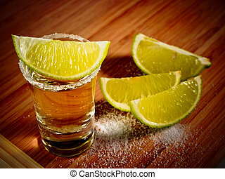 Tequila shot with salt rim and lime wedges