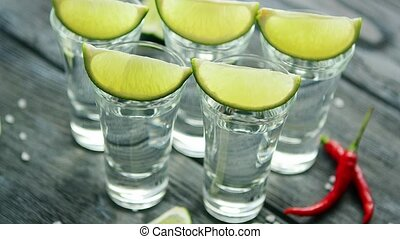 Tequila shots served on table - From above tequila shots...