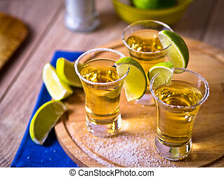 Tequila shots with wedges of lime and salt