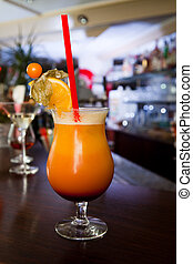 Tequila sunrise cocktail standing on the counter