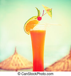 Tequila sunrise cocktail with fruits decoration