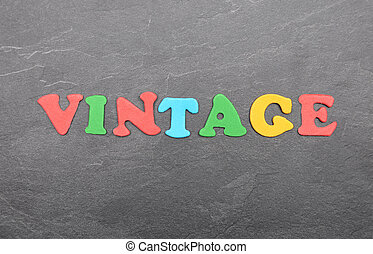 Term from colorful letters on slate board