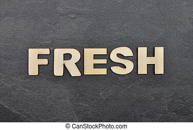 Term from wooden letters on slate board
