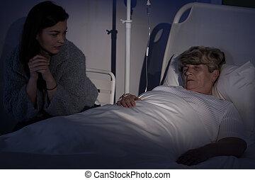 Terminally ill woman in hospice