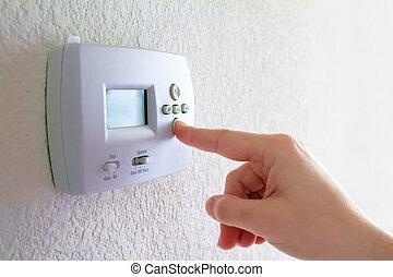 termostato, mano humana