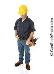 terneergeslagen, de arbeider van de bouw