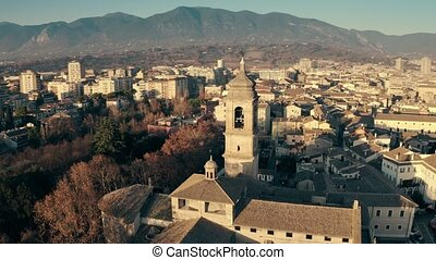 Terni Cathedral and the cityscape in the evening, aerial...