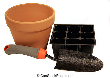 terra cotta pot and trowel