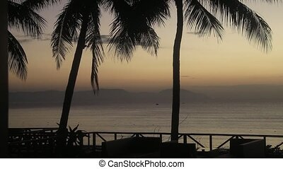 Terrace at sunset on a tropical beach for use in ...