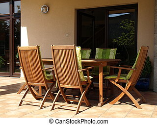 Terrace equipment: wooden table and chairs