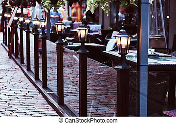 Terrace of a cozy cafe on the street.