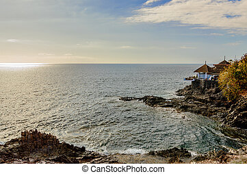 Terrace Of A Payoza On A Cliff With A Privileged View Of The Infinite Ocean At Sunset Beach Las Americas. April 11, 2019. Santa Cruz De Tenerife Spain Africa. Travel Tourism Street Photography.