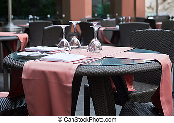 table and chairs in a restaurant cafe terrace
